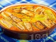 Бърза и вкусна запеканка от тиквички с ориз и заливка от яйца, брашно и прясно мляко
